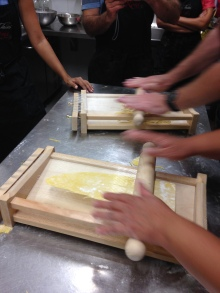 Using the chitarra to cut pasta