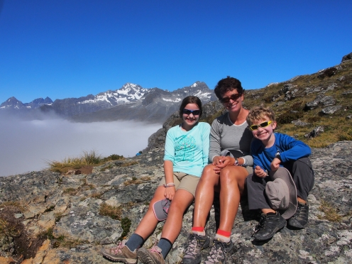 We break above the clouds at Ocean Peak corner between Lake Mackenzie and Harris Saddle