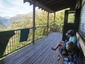 Reading at Routeburn Falls Hut after a 11.3km walk